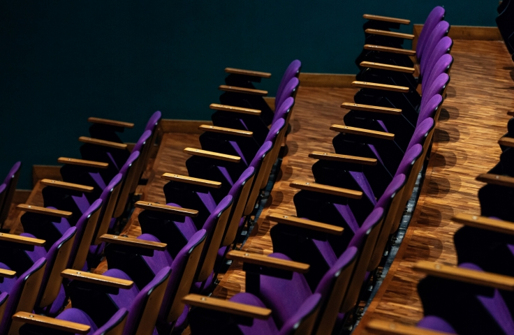 rows of purple chairs in lecture
